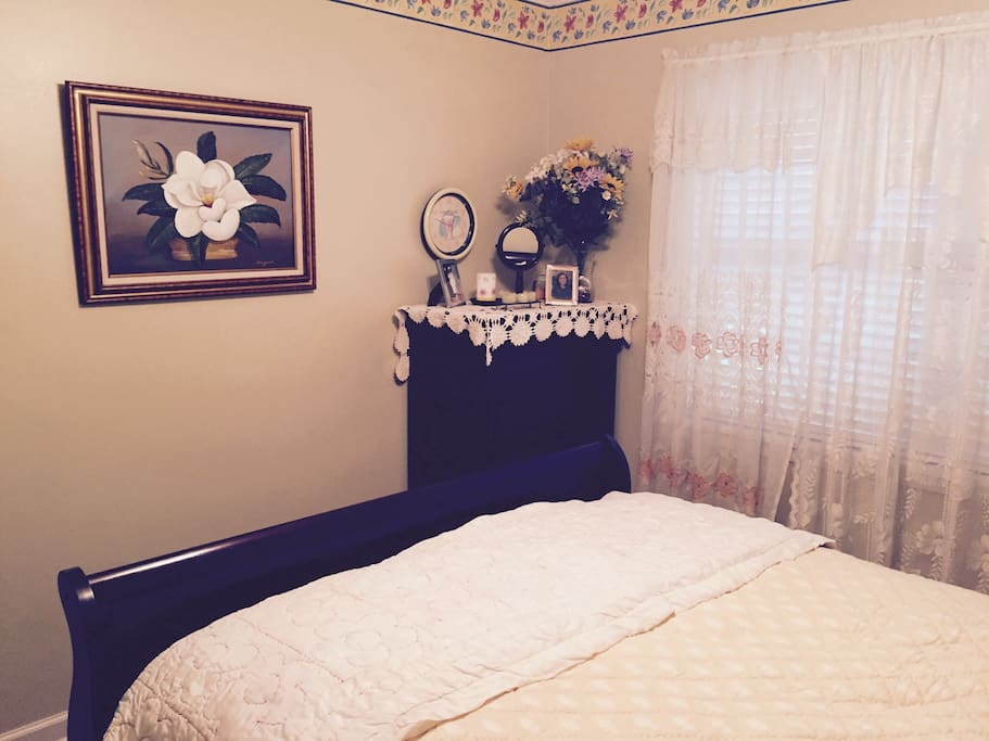 Nice clean, comfortable queen sized bedroom with a chest of drawers for clothes, and closet space.