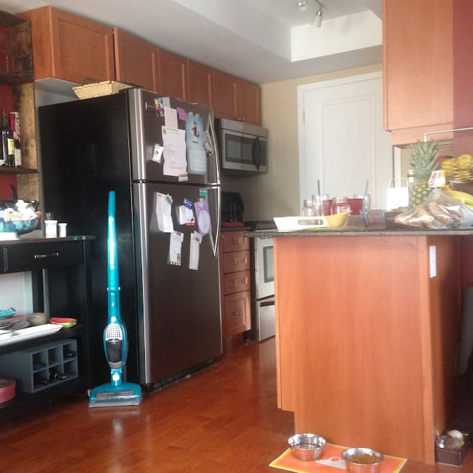 (Sorry it's sideways!) Kitchen with full fridge, microwave, espresso machine, dishwasher, stove, oven.