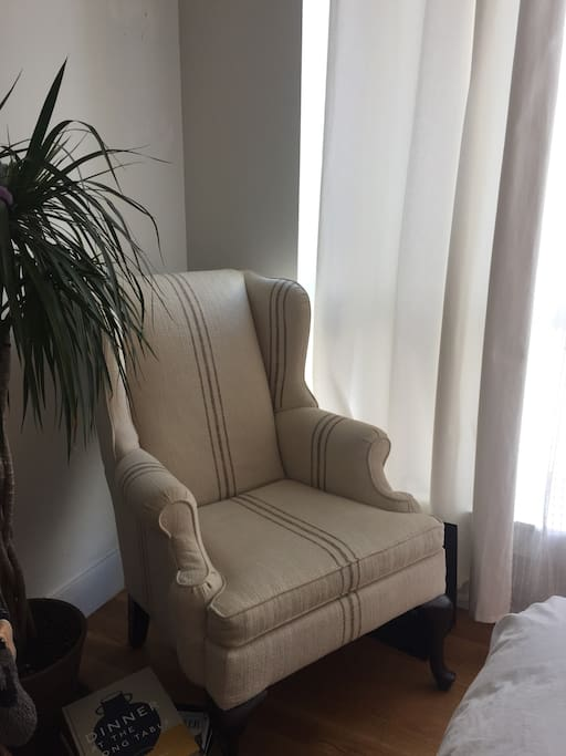 Chair in the room by the huge window