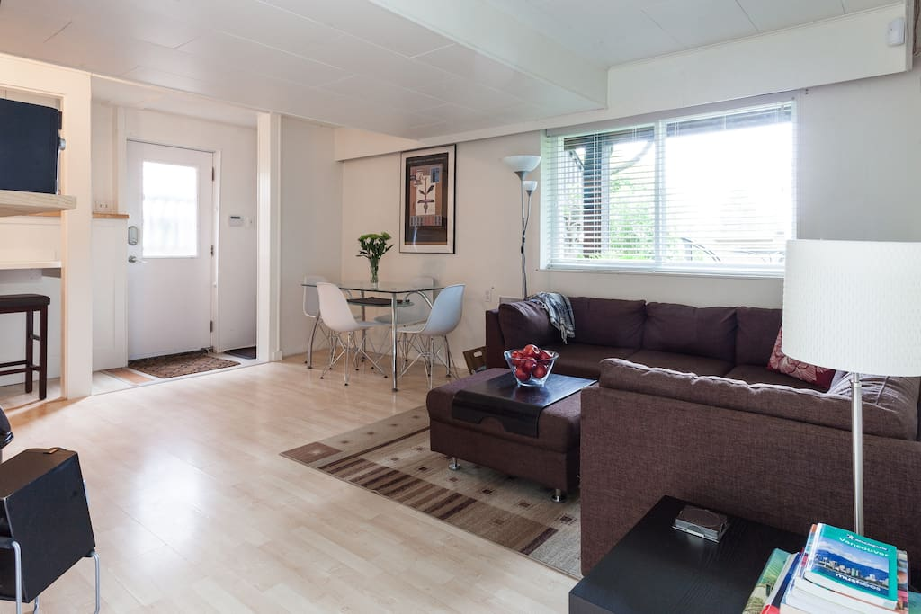 """Living Room/Dining Area, Entrance. Large, bright windows with """"peek-a-boo"""" mountain views."""