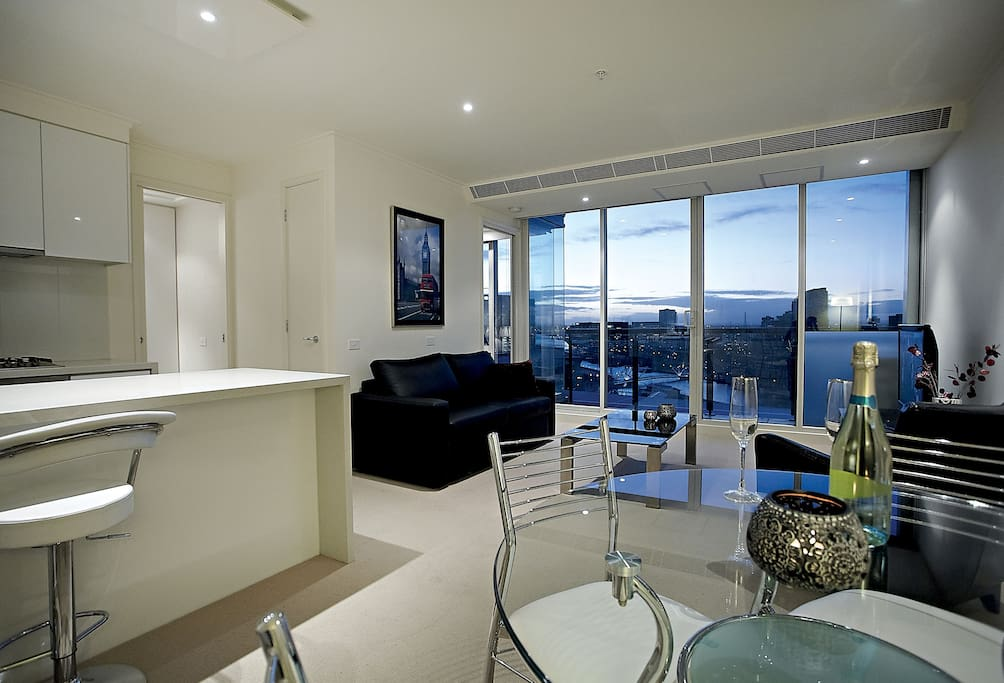 Open plan living area with amazing city and river views