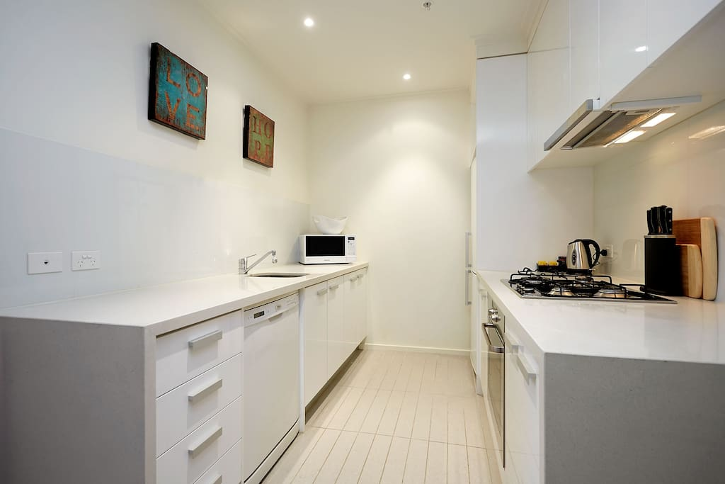 Fully equipped kitchen with extra large fridge