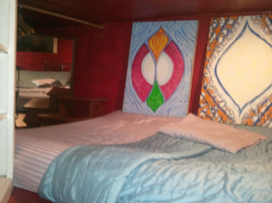 super comfrotable queen sized futon..sleeps two..charming artistic ambiance