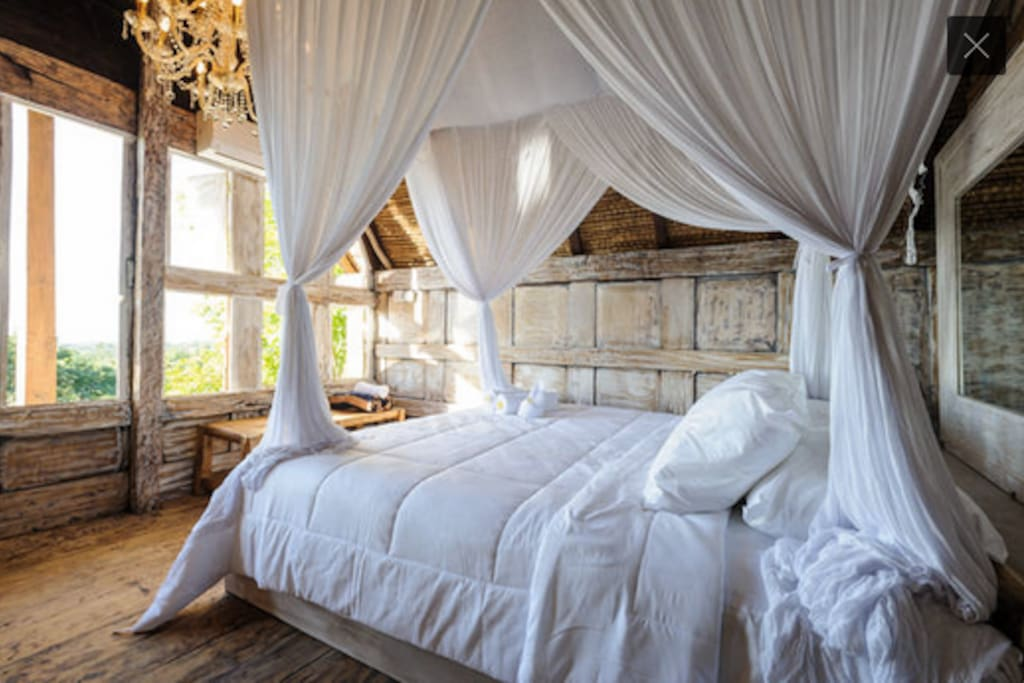 Bedroom upstairs wit AC and mosquito net