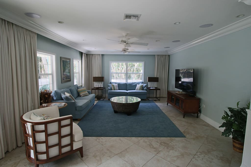 """Living room with 60"""" Smart TV, cable, DVD and Sonos system"""