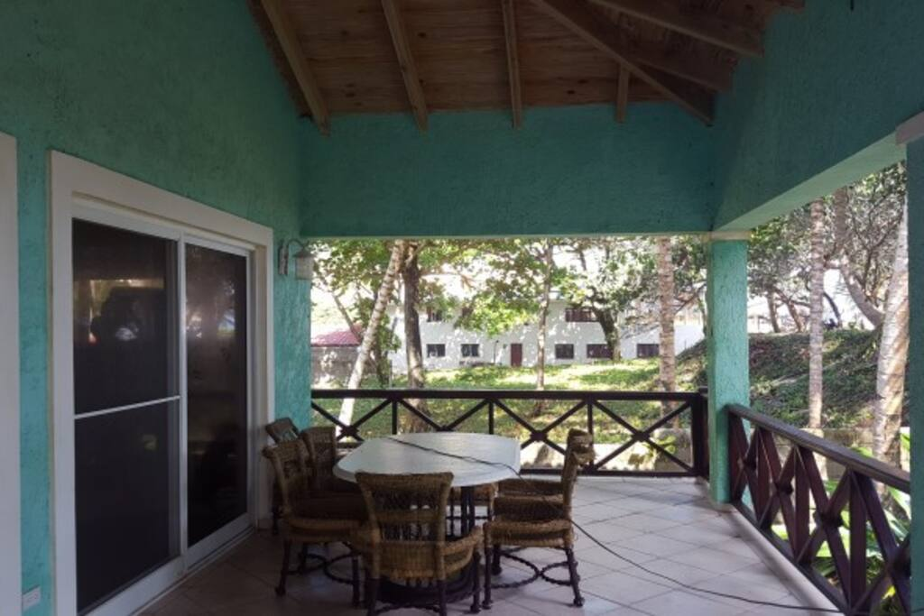 Huge 1500 sq ft balcony with dinner table and beach chairs.