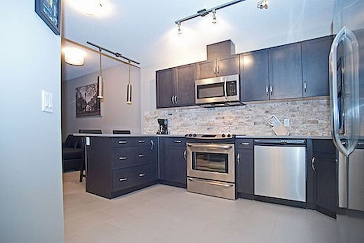 Gorgeous kitchen fully equipped with dishes and all small appliances and dining area