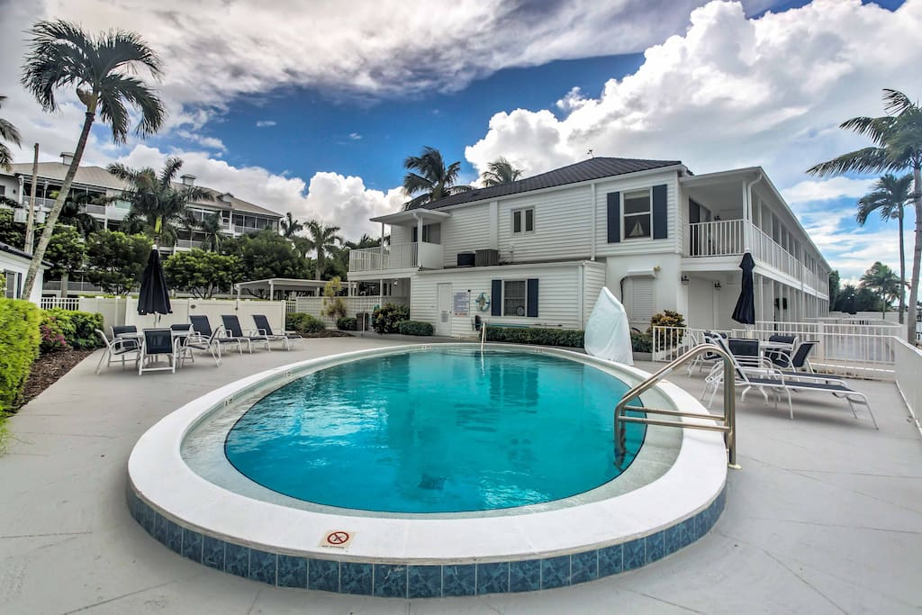 This property offers fantastic views of Collier Bar and Big Marco Pass, along with a dock and access to community amenities.