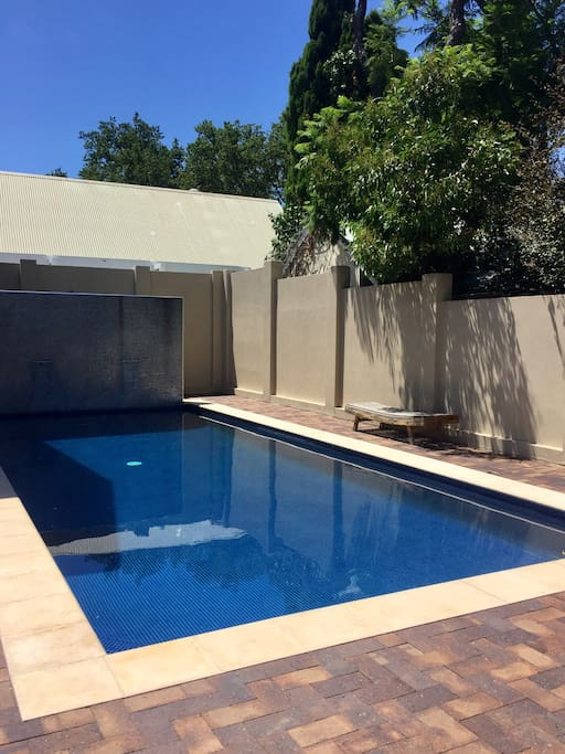 Heated, fenced off pool with fountain