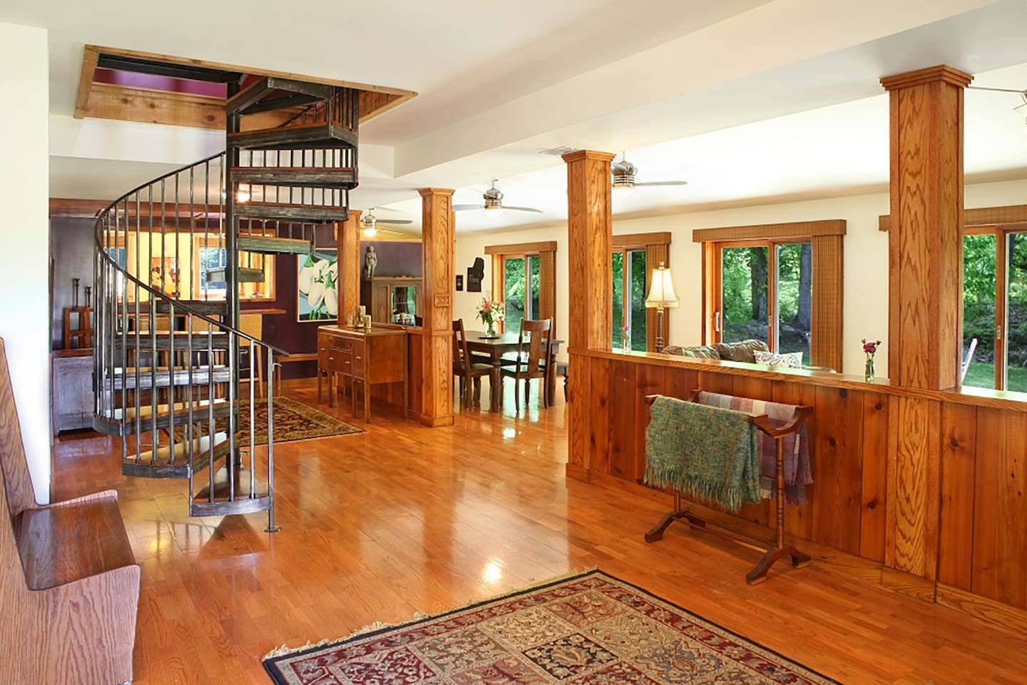 The entry way is flooded with natural light. The spiral staircase was custom made by a local artist.