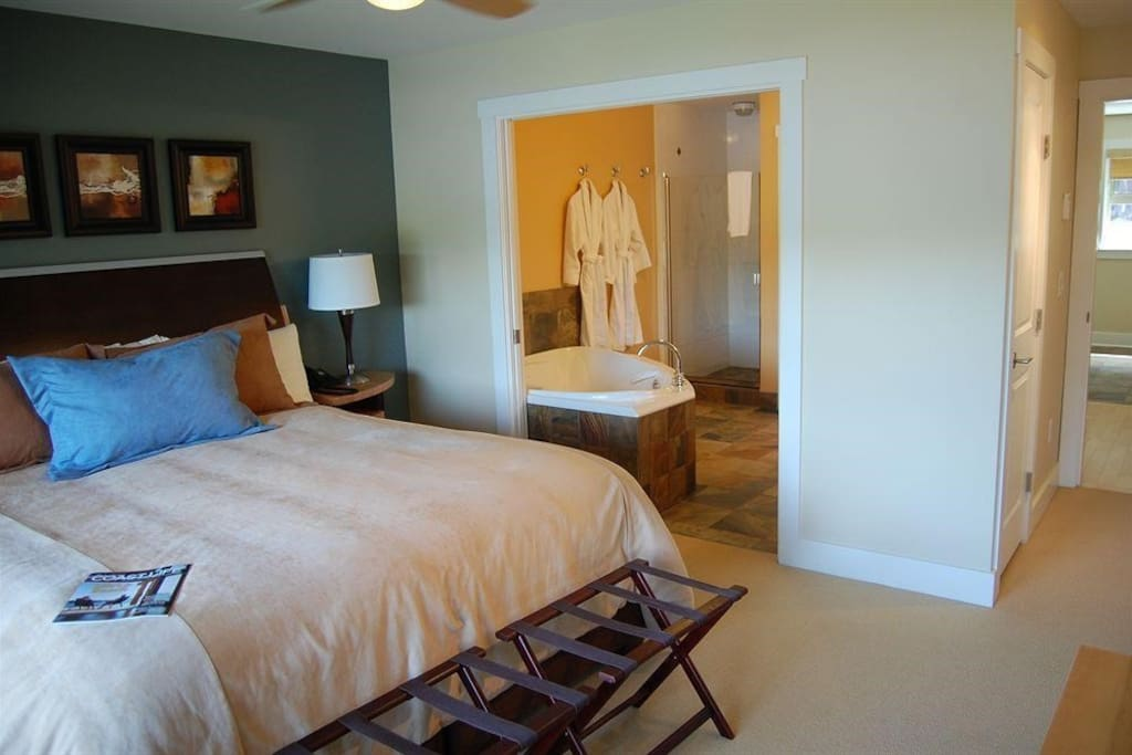 The master bedroom has an en suite bathroom with a jetted tub.