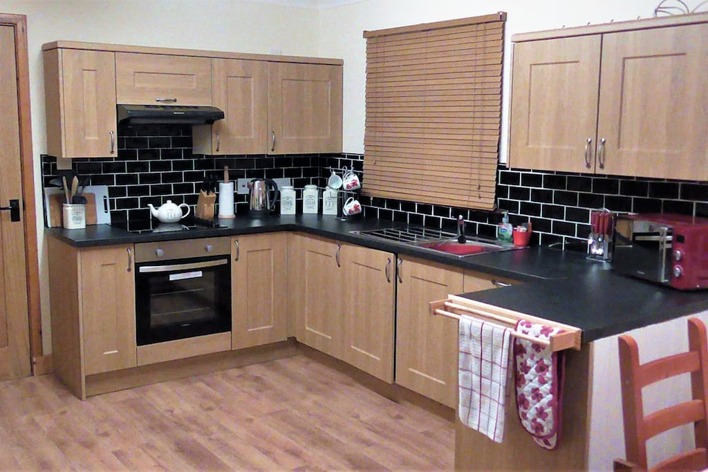 Large kitchen/diner with wooden blinds. Fully equipped kitchen and dining area, everything you possibly need is provided.