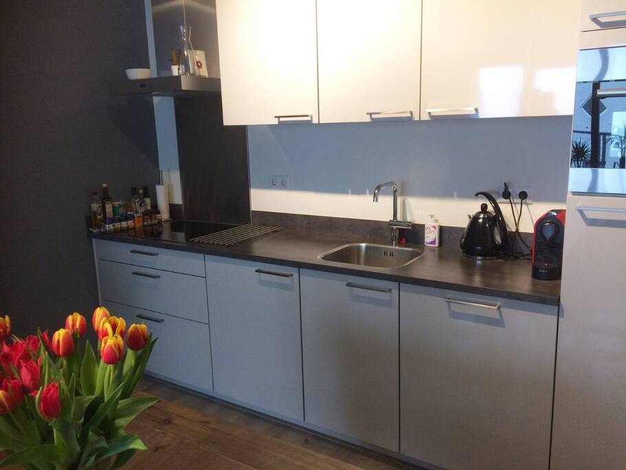The kitchen, which has all facilities you need. Like an oven and dishwasher. You can also make tea and use our luxery nespresso machine.