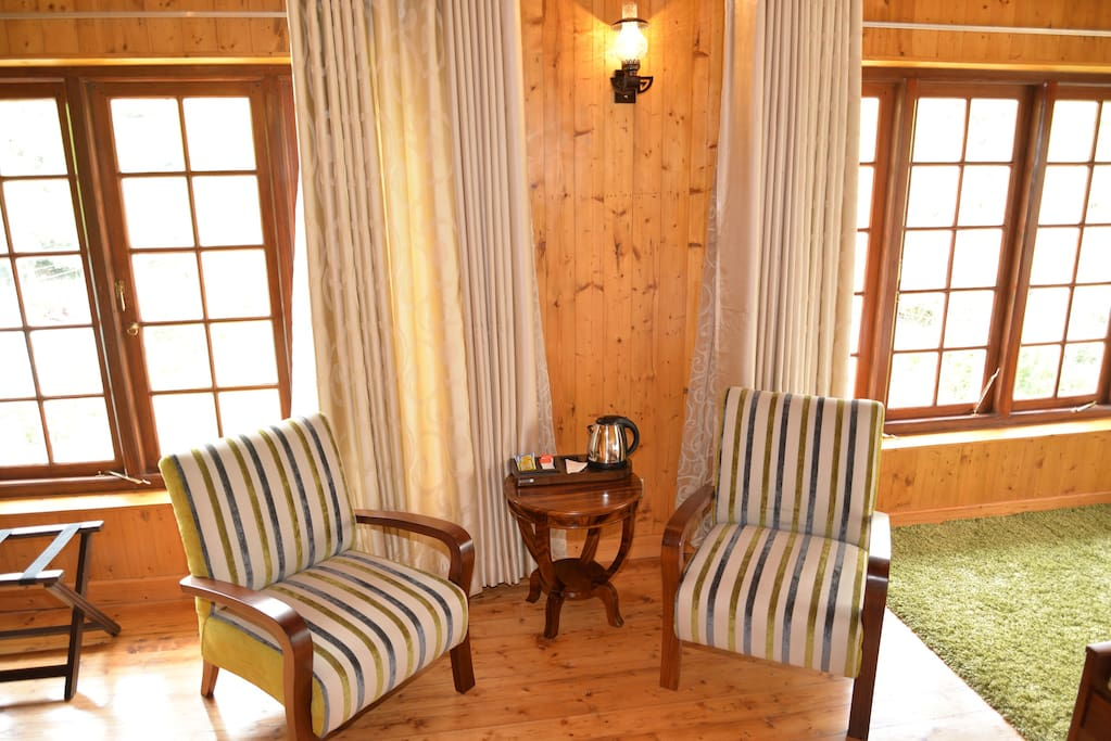 Private seating area with the personal Tea kit in-room.