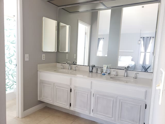 Double Sink separated from restroom and shower.