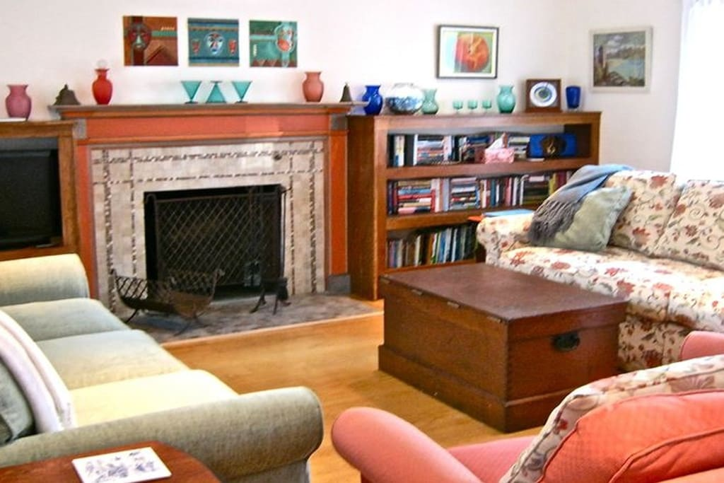 The fireplace room with comfy seating, games, books, and TV/DVD player