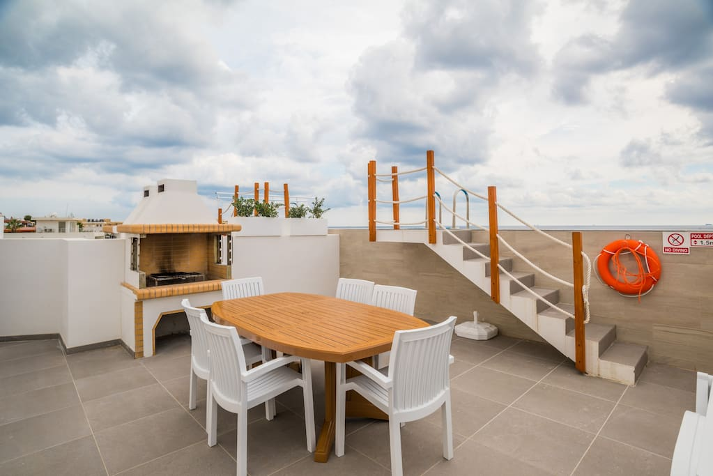 Outdoor Area equipped with; table, chairs and barbecue