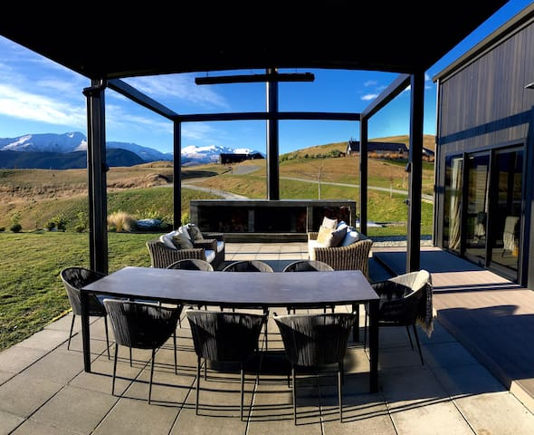 Outdoor dining area under a louvered pergola