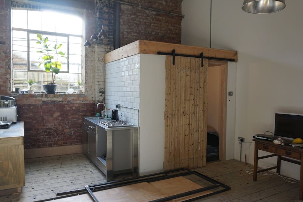 Bathroom is accessed via sliding barn doors