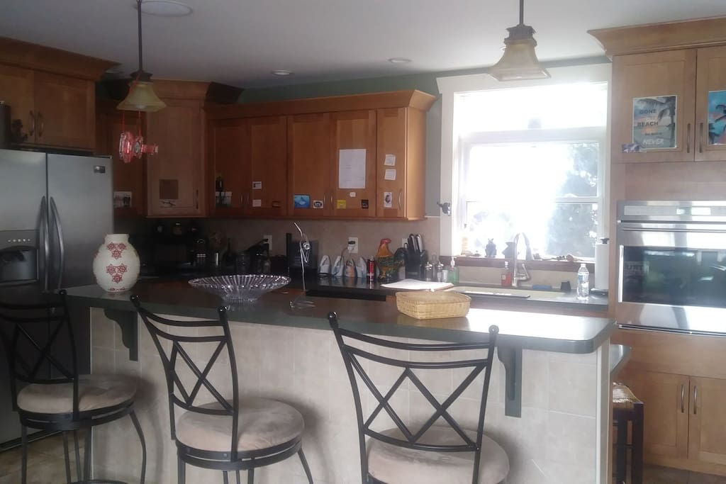 large kitchen with island/rangetop combo. All stainless appliances
