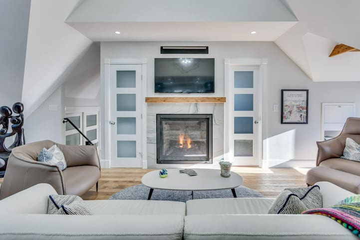 Gas fireplace warms the space on chilly evenings.