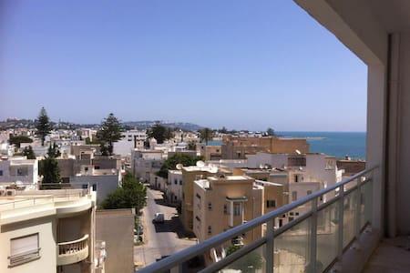 Magnifique appartement S+3 meublé front de mer - ตูนิส