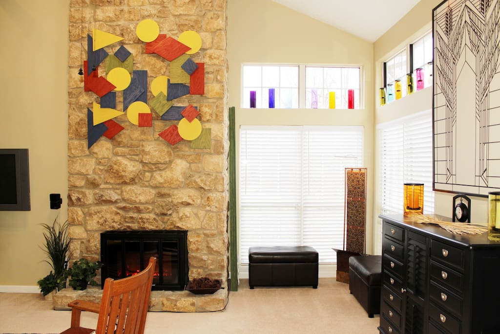 Example of custom art over the electric fireplace. Lots of light from corner windows.