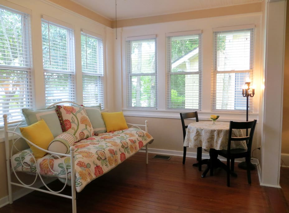 Nice open foyer with a daybed that's great for reading and naps!