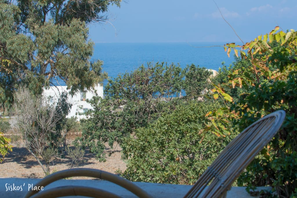 Outdoor patio and view towards the sea