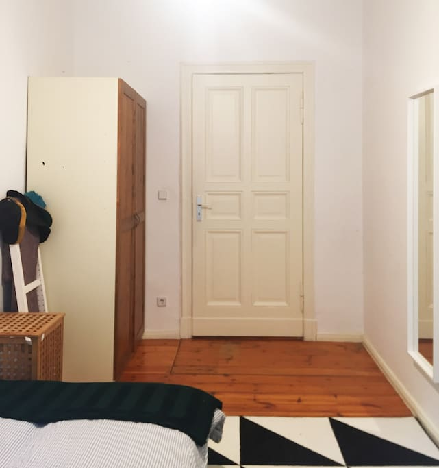 Room with closet, mirror and small table