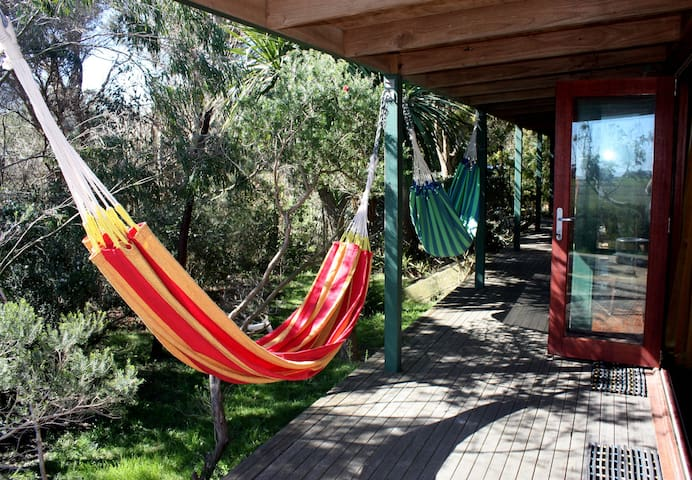 North facing deck allows you to relax in the shade of native trees.