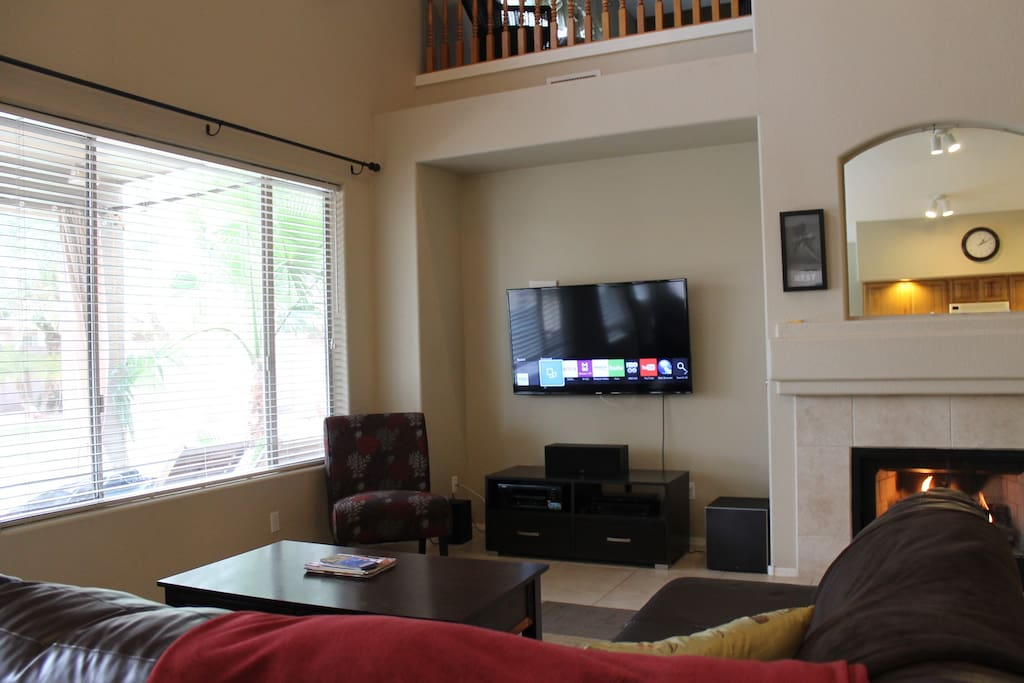 "Family room with 55"" Smart TV opening to kitchen"