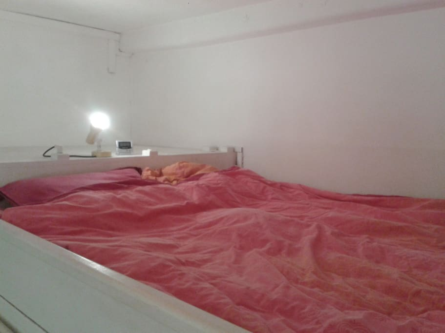 the raised double bed