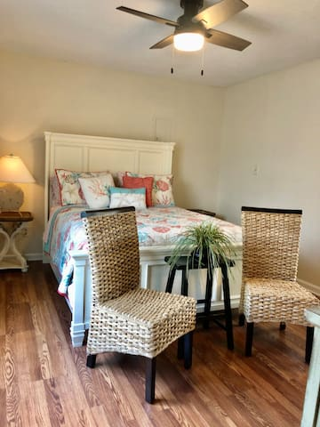 Cozy and comfortable bedroom with queen size bed, night stands  w/lamps for reading and extra sitting area.