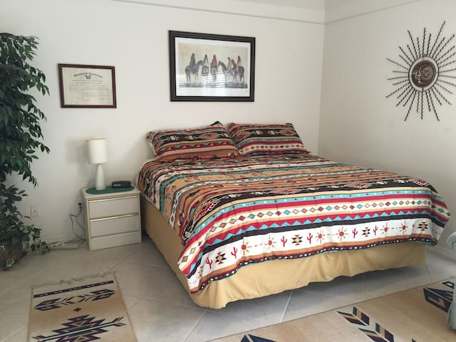 Lower level master bedroom with king bed