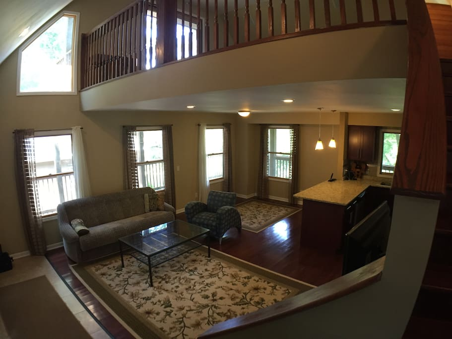 Overlooking main floor family room, dining area and kitchen. Loft space above