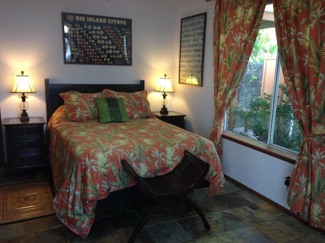 Bedroom #3 at Hale Mar has windows on two sides and sliding glass doors to the ocean facing lanai.