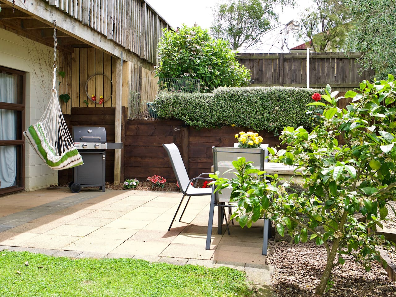 Private courtyard. BBQ and outside furniture.