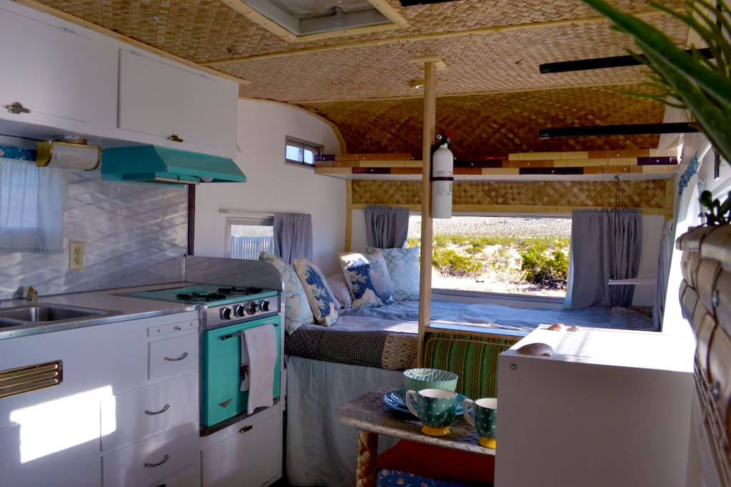 """First views as you enter """"The Aloha"""". Check out that huge window behind the bed!"""
