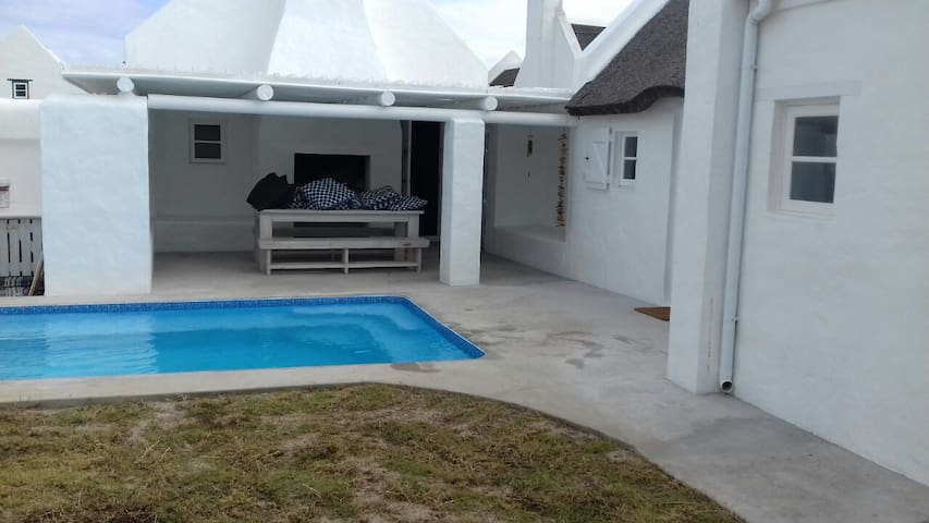 Outside entertainment area with pool