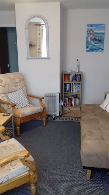 The living room with sofa bed suitable for one person.