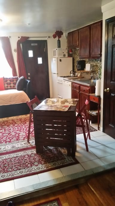 Current Set up with table for 2 - 3, placed where the victorian chair is in the listing photo