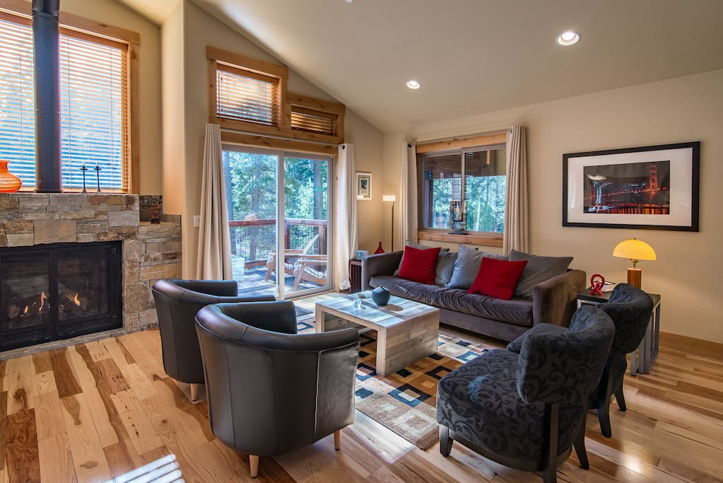 The modern yet comfortable living room with cathedral ceiling and fireplace
