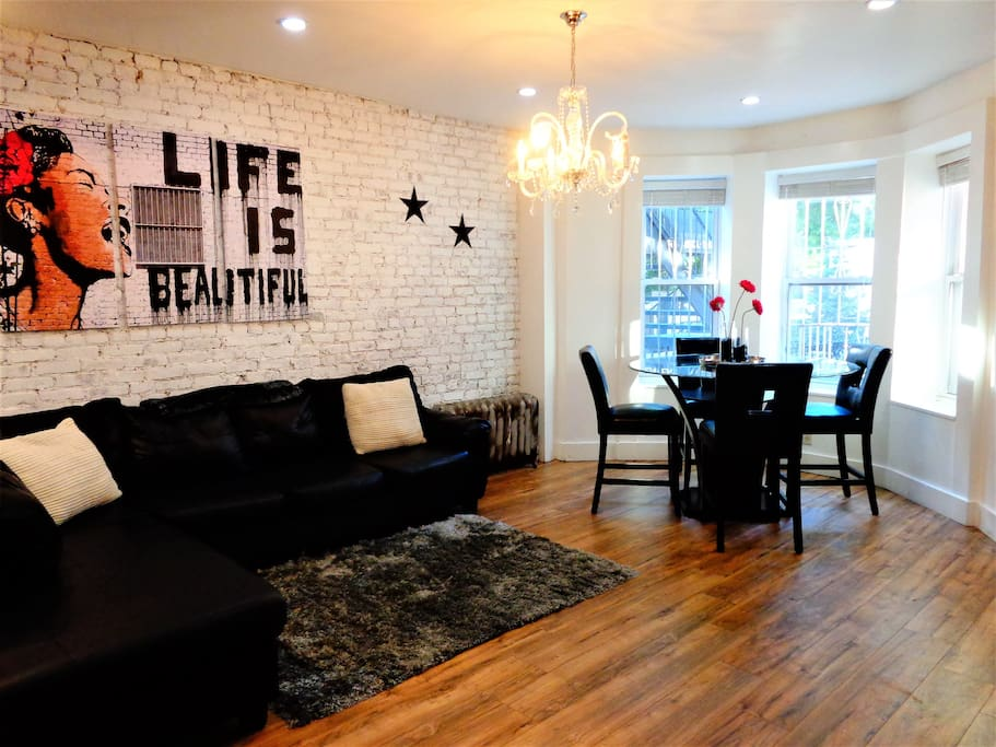 Living and Dining Area. Bay window offers view of beautiful, tree-lined Eastern Parkway.