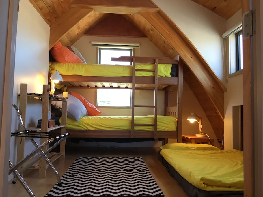 'Kids' bedroom with bunk bed  and an extra mattress,if needed, on ground. Also upstairs