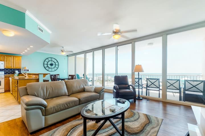 Beach condo w/ a private balcony, shared pool, & gym in a central location
