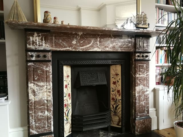 Original Victorian fireplaces throughout