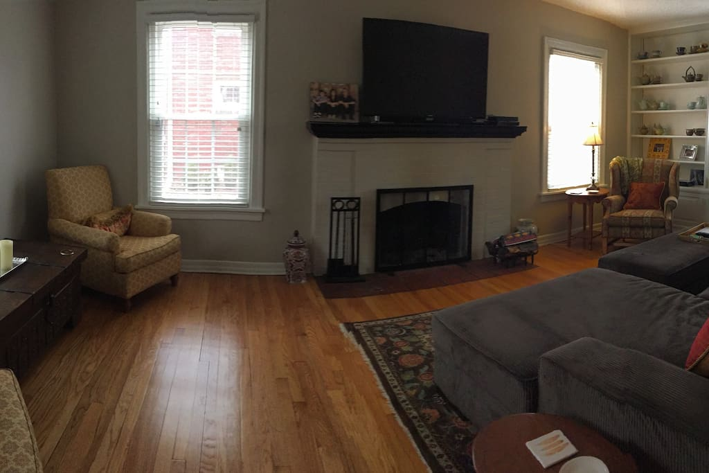 Spacious Comfortable Living Room with Big Screen TV and woodburning fireplace!
