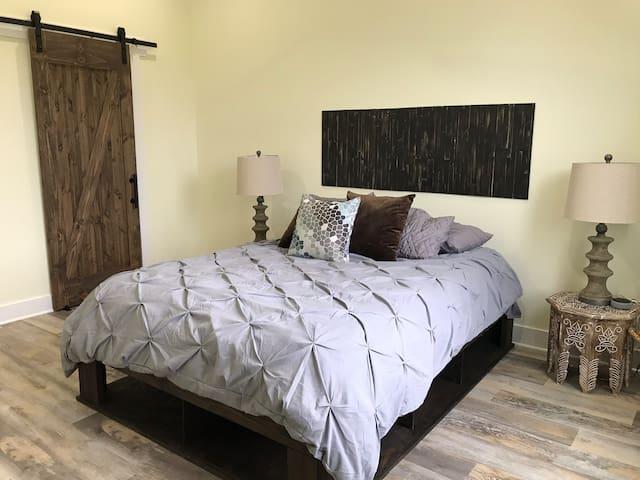 Master Bedroom with queen bed and en-suite