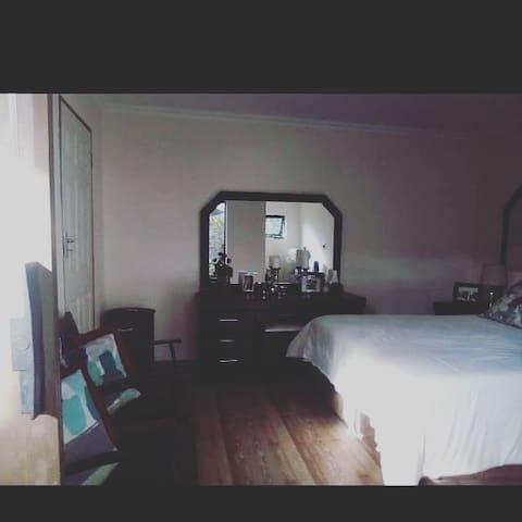 Standard large bedroom, one queen size bed, en suite bathroom and Kitchen area.